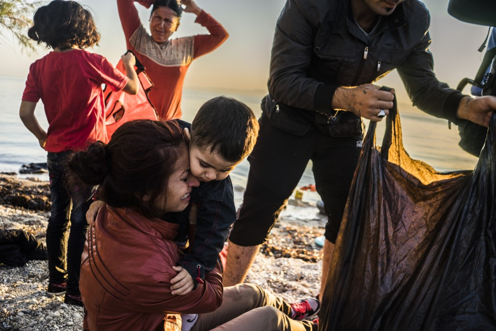 A Syrian mother just arrived to the coast of Lesvos with her husband and her son. Sept 5th, 2015