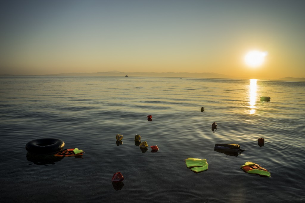 Life jackets and arm-floats are flowating on the sea of Lesvos where minutes ago an inflatable boat carrying about 50 refugees has arrived. Sept 5th, 2015.