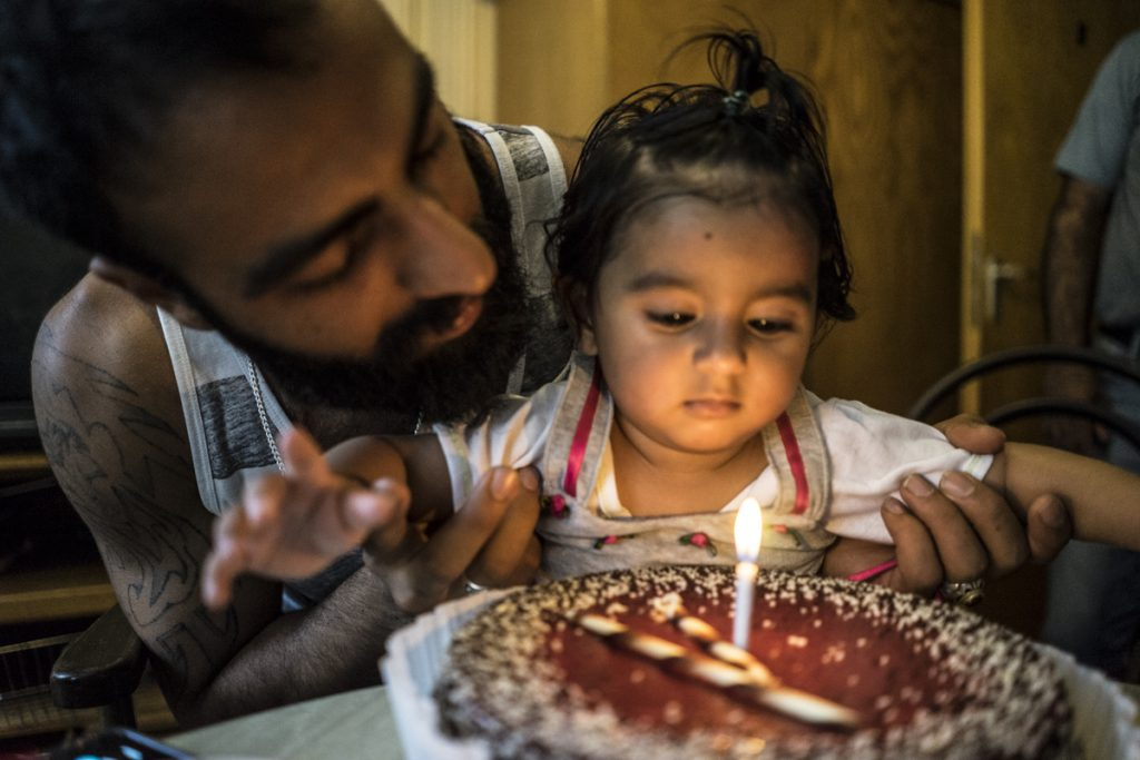 Rahim* and his daughter Mitra before she blew out her birthday candle. Sept 5th, 2016